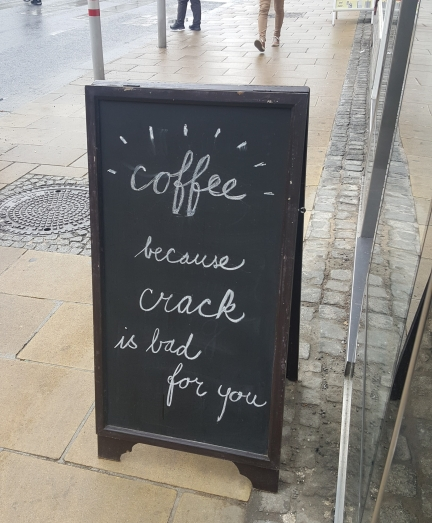 "Sidewalk sign reading, ""Coffee, because crack is bad for you"""